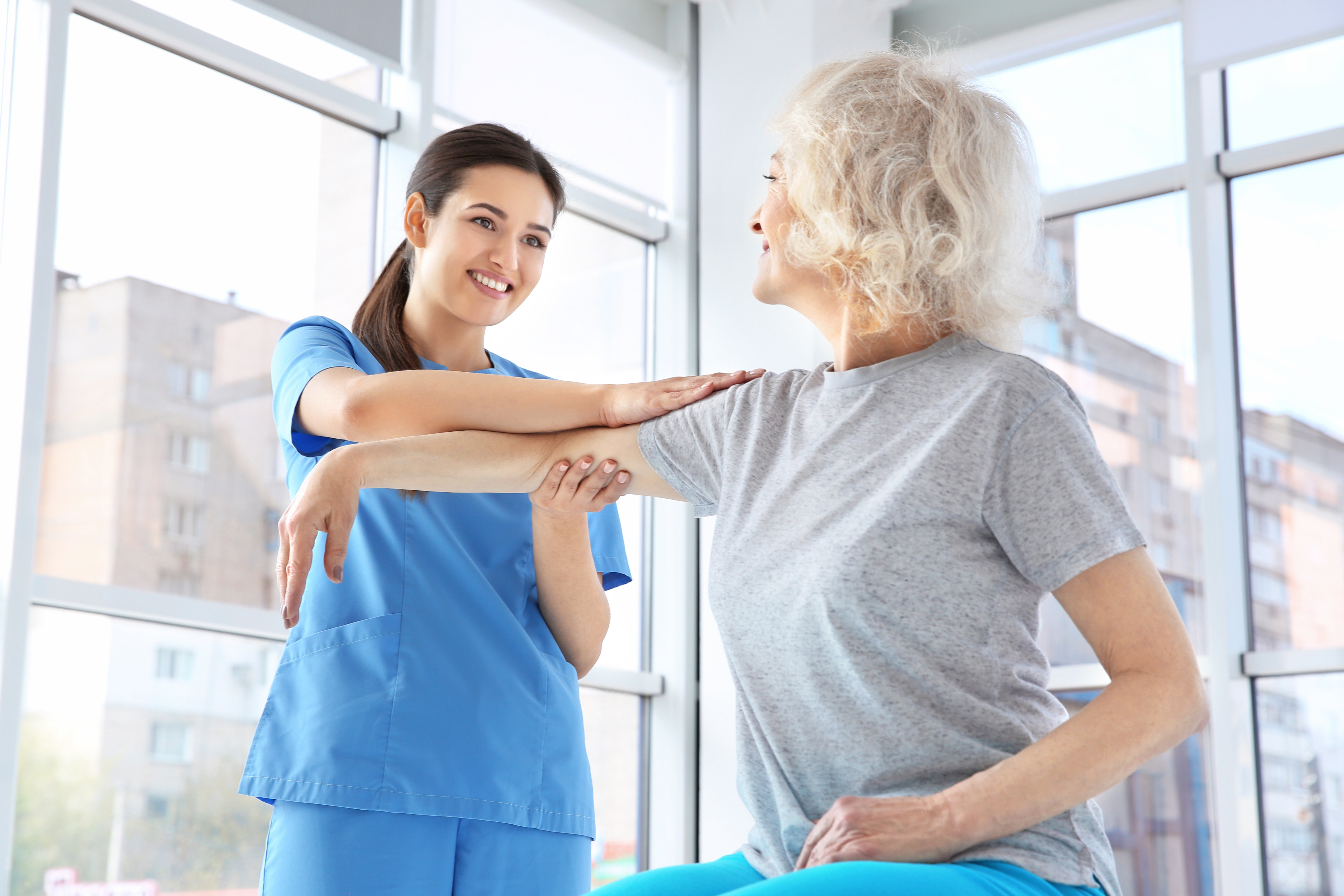 physical therapist working with elderly patient