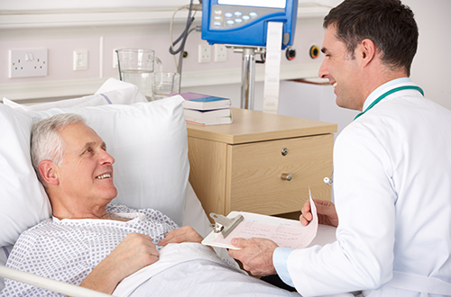 urologist reviewing post-operative instructions with patient in hospital