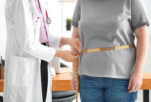 weight management doctor with patient